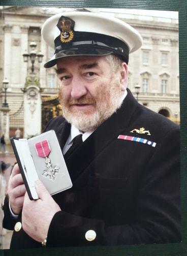 Trevor McGrath pictured after receiving his MBE at Buckingham Palace