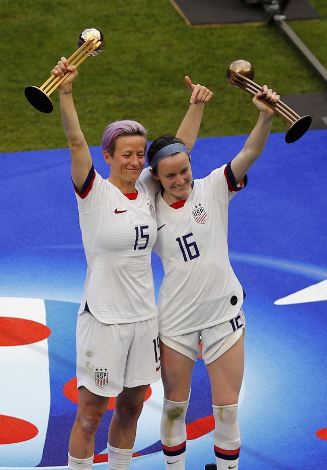 Megan Rapinoe and Rose Lavelle celebrate the United States' triumph in the women's World Cup in Lyon (Photo – AP/Francois Mori)