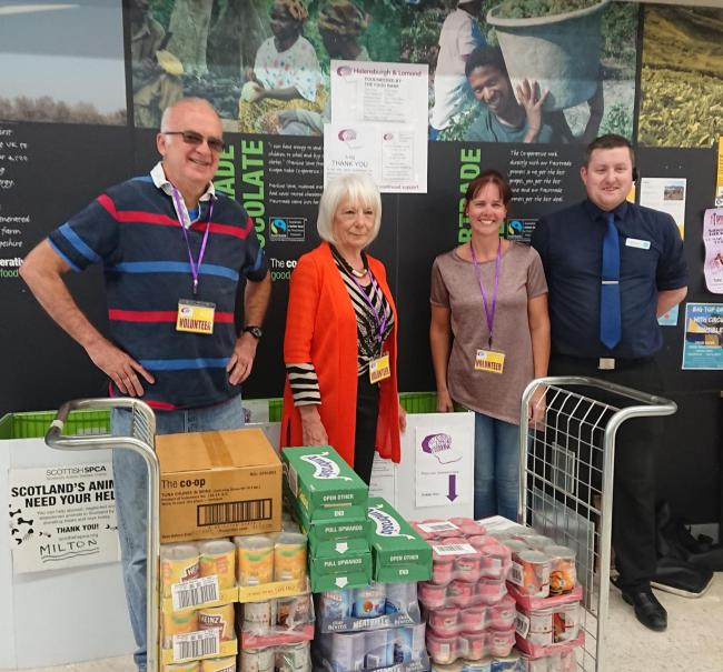 Food bank volunteers collect the generous donation of supplies from Helensburgh Co-op's Russell Stillwell, right