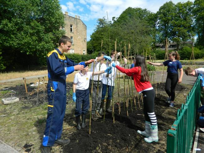 Eco Schools pupils hard at work in the community kitchen garden