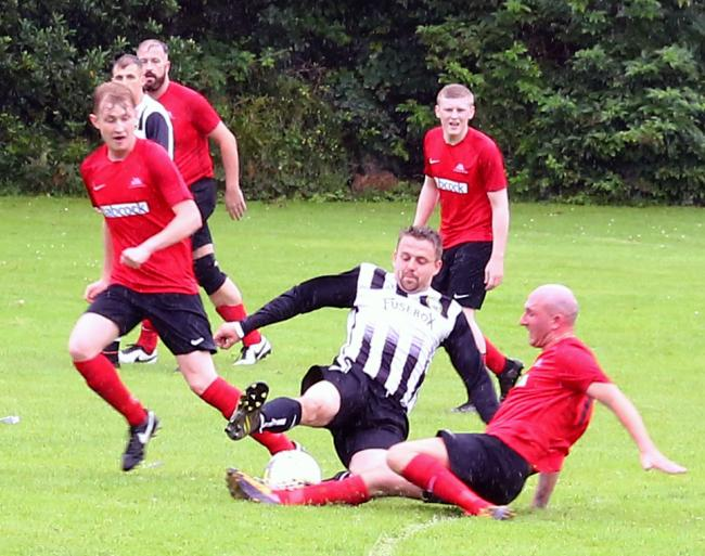 Rhu Amateurs, seen here in red in a pre-season friendly against Helensburgh, won their opening two Caledonian League fixtures