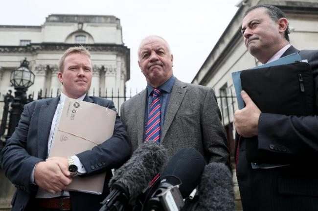 Raymond McCord, centre, and solicitors Ciaran O'Hare, left, and Paul Farrell outside the Royal Courts of Justice, Belfast