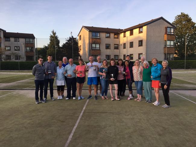 Craighelen Tennis Club's 2019 championship finalists, with singles winners Alan Barbour and Anna Scullion holding their trophies in the centre