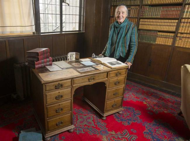 Ruth Currie with her grandfather's desk inside the Hill House in Helensburgh