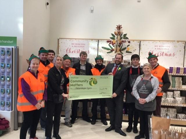 Waitrose staff hand over the cheque to members of the Helensburgh Festive Lighting Charitable Trust