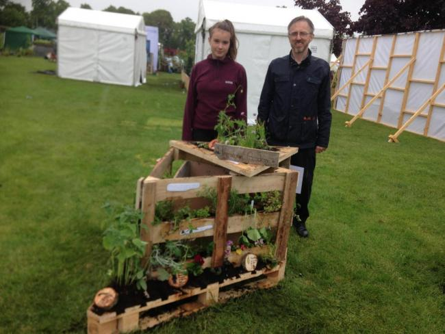 Isabelle Gibrat won the 'water' themed section of Keep Scotland Beautiful's Pocket Garden competition in 2019, with a bit of help from Hermitage Academy technical teacher Sandy Cameron, who is pictured with Isabelle and her winning creat