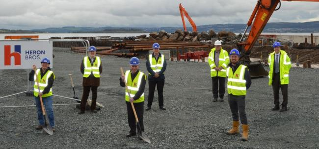 Helensburgh councillor Gary Mulvaney pictured with staff from Heron Bros at the site of the waterfront development