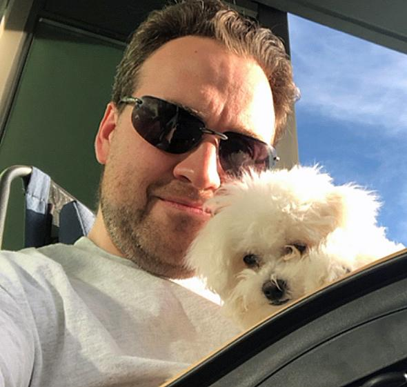 Luke Dicken with Jaina, his one-year-old Bichon Frise