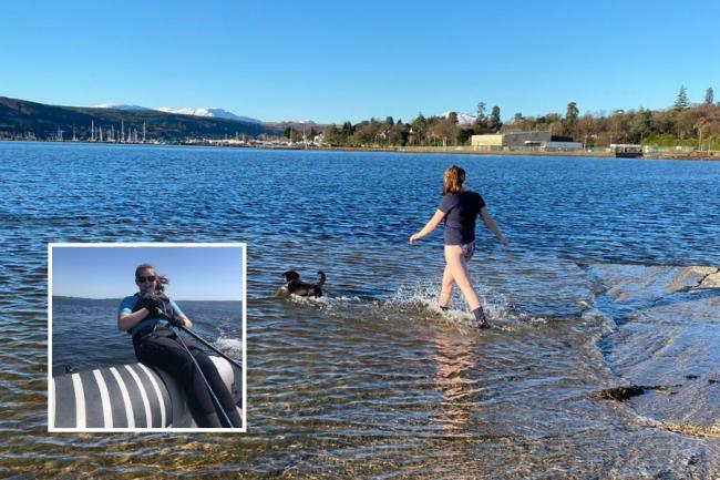 "Eilidh takes a dip in the Gare Loch along with fellow ""water baby"" Max the dog"