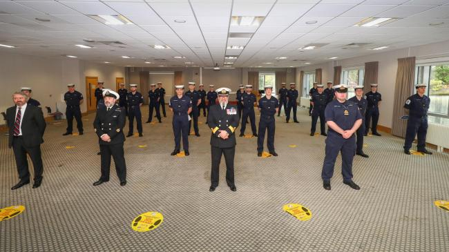 The twenty-four submariner trainees at their passing-out parade with instructors and Commodore Jim Perks, OBE