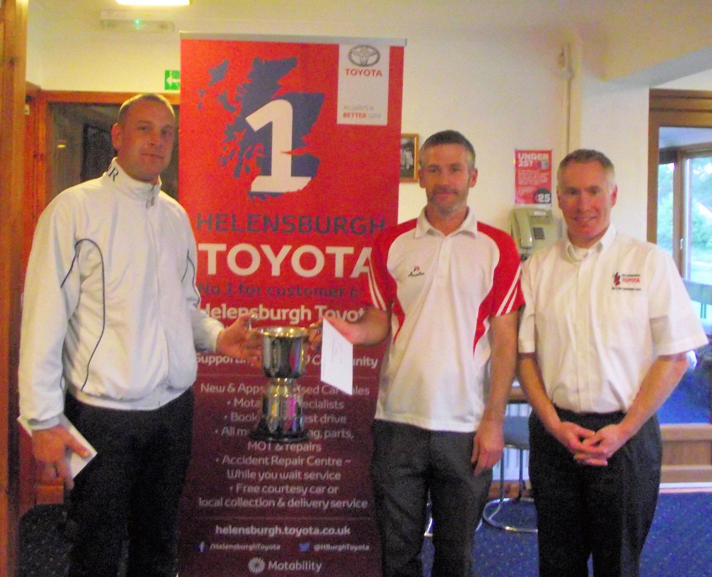 Lee Walters and Andrew Sneddon with sponsors' representative Gary Mulvaney