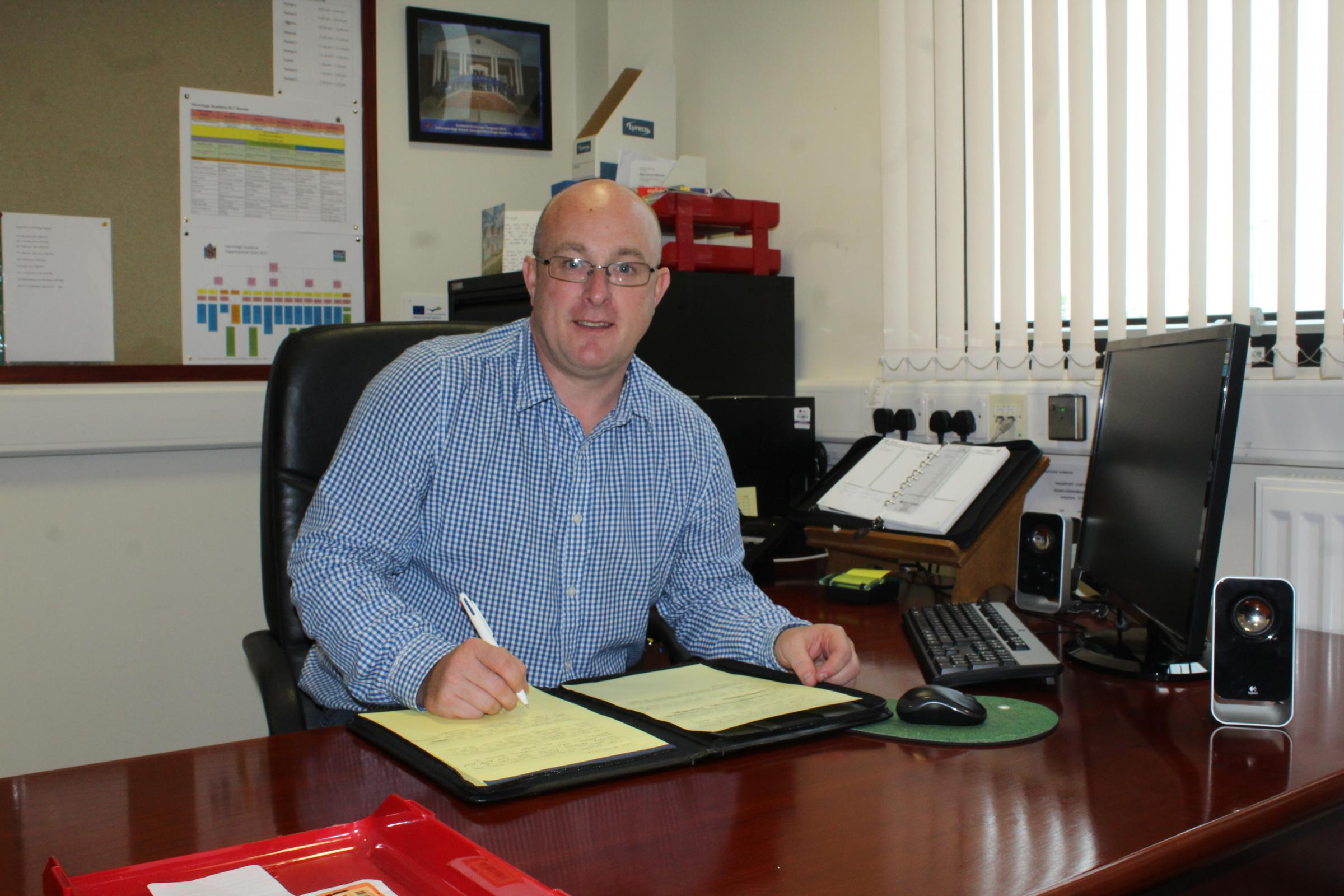 David Mitchell at his desk at Hermitage Academy