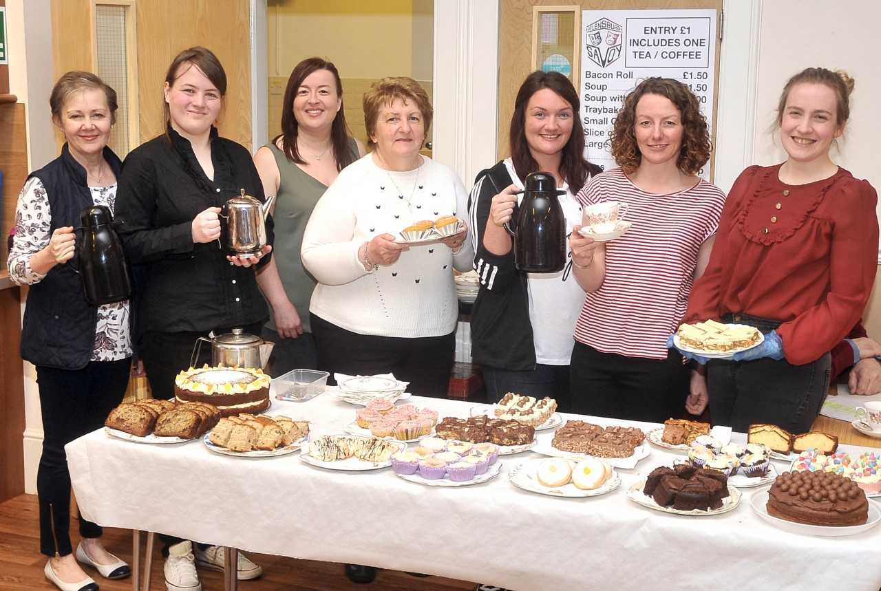 All smiles on the cake stall at the Savoy's craft fair and coffee morning