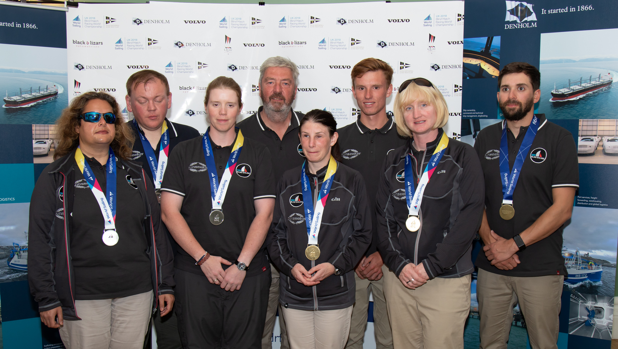 Laura Cammidge (third left) and the GBR1 and GBR2 crews show off their gold and silver medals (Pic - Neill Ross)