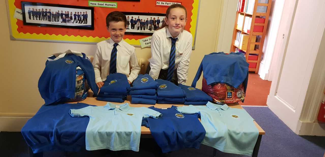 Callum and Allana Roy collecting the jumpers at school