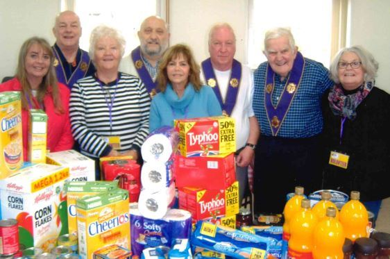 Members of the Neptune Lodge of the Royal Antediluvian Order of Buffaloes with the items donated to the local food bank