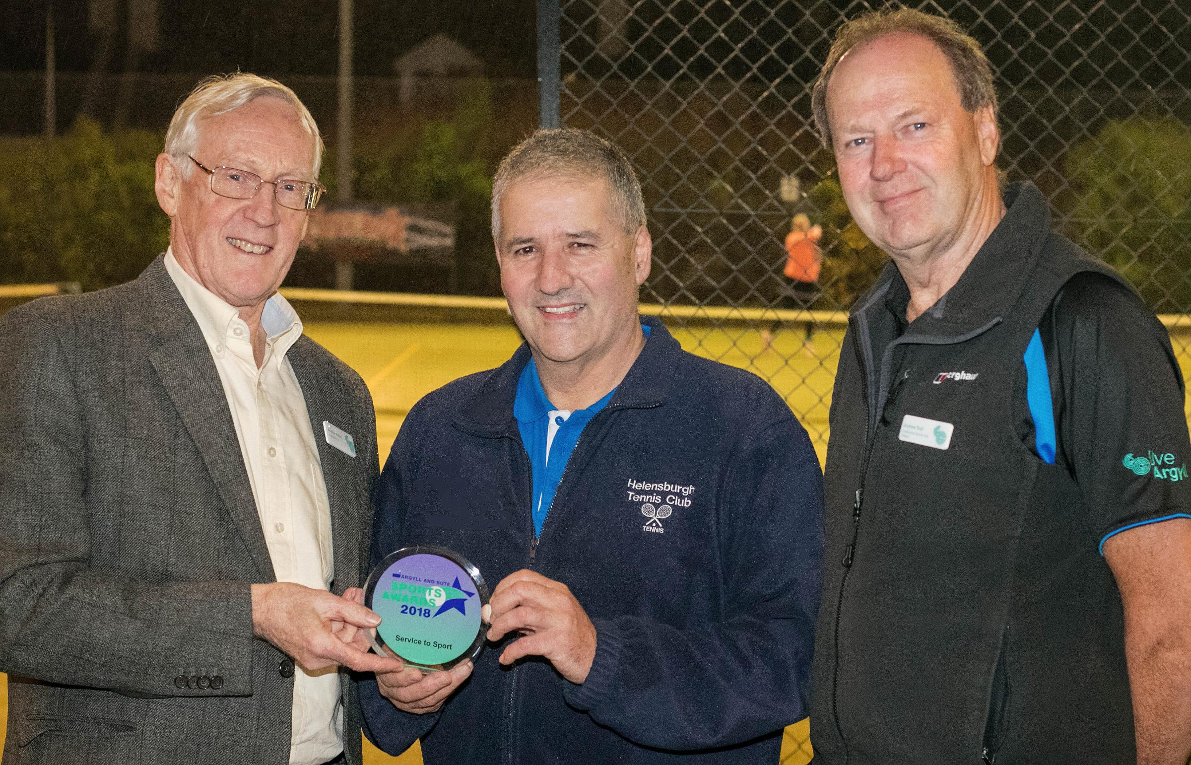 Bobby Kerr (centre) receives his Service to Sport award from Andrew Nisbet and Andy Trull