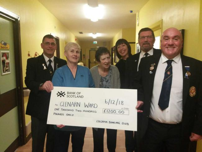 Colgrain Bowling Club members hand over a cheque to staff from the Glenarn Ward at Dumbarton Joint Hospital