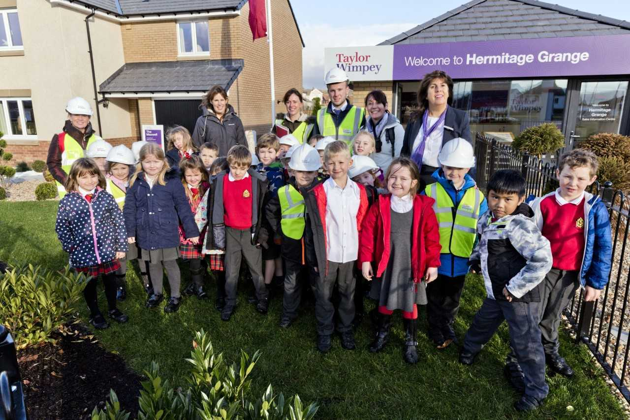 Taylor Wimpey staff welcome Primary two pupils from Hermitage Primary to the Hermitage Grange development in Helensburgh