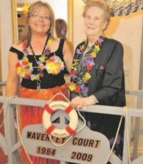 Waverley Court's longest resident, Mary Murray, unveils the new commemorative plaque with scheme manager Sandra Wilkie