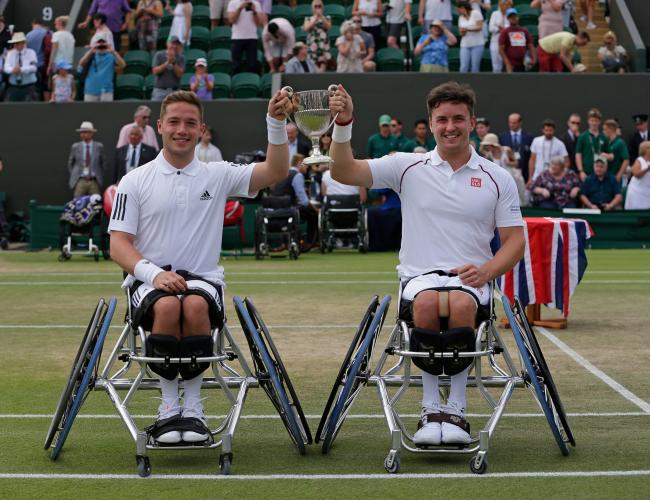 Gordon Reid and his doubles partner Alfie Hewett celebrate their 2018 Wimbledon triumph (Getty Images for The Tennis Foundation)