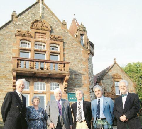 Richard Coates, Sue Saxton, Sir James Cayzer, Richard Reeve, Forbes Ferguson and John Bray outside the refurbished hall