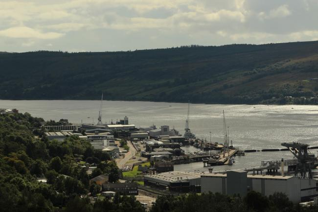 The expansion of HM Naval Base Clyde could put pressure on Helensburgh's green belt, according to a report which recommends a review of the current boundaries