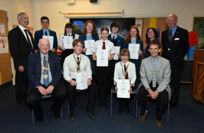 The competition entrants pictured with adjudicator Alan Maclean, teachers Pamela Frew and Douglas Fleming, and members of Helensburgh Garelochside Rotary