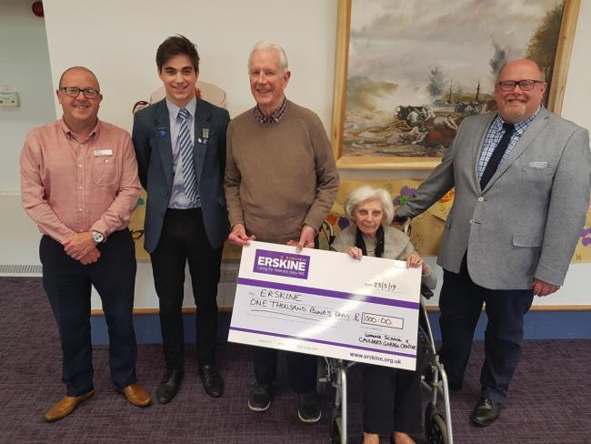 Pictured with Erskine residents Michael and Sarah and community fundraiser Jim Watret are Joe Bull, the school vice-captain and head of the charity committee, and Alister Minnis, depute head.
